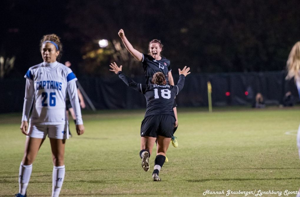 Rachel Cooke and Brooke Kowalski Celebrate Win Against CNU. Photo retrieved from Lynchburg Sports. Nov. 11.