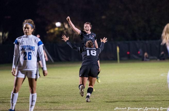 Rachel Cooke and Brooke Kowalski Celebrate Win Against CNU. Photo retrieved from Lynchburg Sports. Nov. 11.