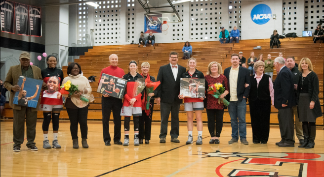 Seniors from the women's basketball team pose with their families. Feb. 10, 2018. Retrieved from lynchburgsports.com.