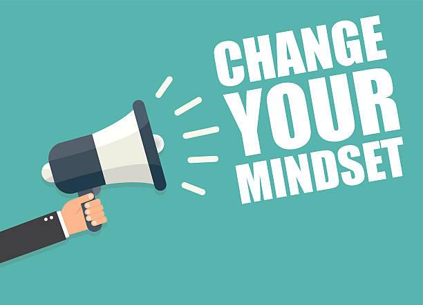 Change your mindset. Hand holding megaphone