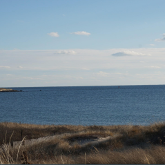 This photo is taken at Watch Hill in RI. Usually there would be fishing boats around but it is completely empty.