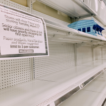 This photo was taken at a dollar general in Warwick RI. Customers have a limit of 3 for paper products hand sanitizer and wipes, but the shelves are empty.